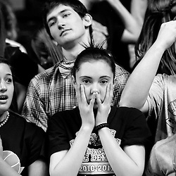 Kyle Green | The Roanoke Times<br /> 3/10/2012 Christiansburg High School boys basketball fans catch their breath after Christiansburg missed a shot at the end of regulation against Grafton High School during the VHSL state basketball finals game at the Siegel Center in Richmond, Virginia on Saturday. Christiansburg defeated Grafton 70-69 in overtime.