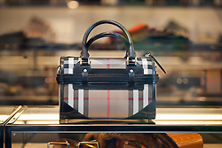 © Licensed to London News Pictures. 07/11/2012. London, UK. A Burberry hand bag is seen in the company's Regent Street store in London. The clothing company today announced a 30% loss in profit for the brand, but insisted that the company was still strong. Photo credit: Matt Cetti-Roberts/LNP