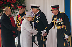© London News Pictures 20/10/2015. Her Majesty The Queen and The Duke of Edinburgh meet Defence Chiefs of Staff.<br /> <br /> More than 1,100 soldiers and 230 horses joined HM The Queen, HRH The Duke of Edinburgh, The Duke and Duchess of Cornwall, the Prime Minister, Senior members of the Cabinet, the Lord Mayor of London, the Mayor of London, and the Defence Chiefs of Staff for the ceremonial welcome to Britain of The President of The People's Republic of China and Madame Peng Liyuan . Photo credit: Rupert Frere/LNP
