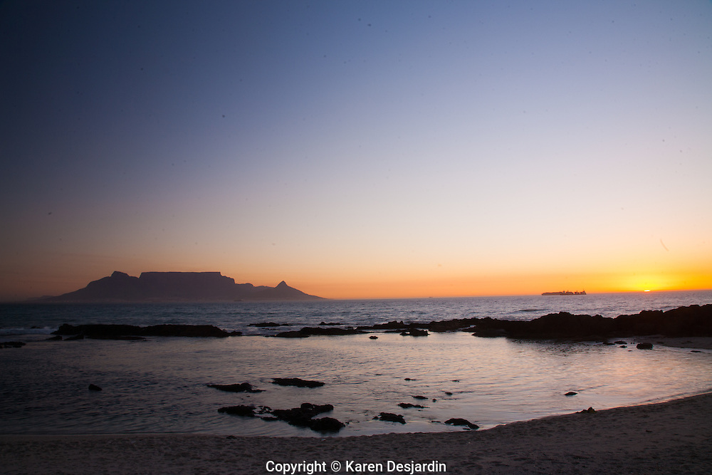 Sunset over Table Mountain which rises above the city of Cape Town, South Africa.