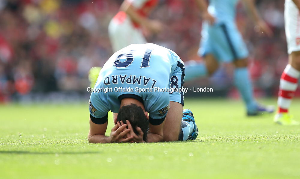 13 September 2014 , Premier League ,  Football Arsenal v Manchester City - Frank Lampard of City holds his head as he kneels on the turf injured.<br /> Photo: Mark Leech