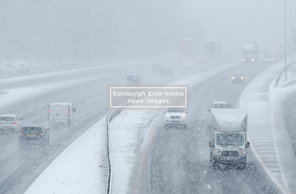 Heavy Snowfall in West Lothian, Wednesday, 4th April 2018<br /> <br /> More heavy snow fell in West Lothian this afternoon causing traffic problems for drivers on the M8 Edinburgh to Glasgow motorway<br /> <br /> Alex Todd | EEm