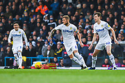 Liam Cooper of Leeds United (6) has the ball to pass as Pablo Hernandez of Leeds United (19) and Aapo Halme of Leeds United (52) look on during the EFL Sky Bet Championship match between Leeds United and Bristol City at Elland Road, Leeds, England on 24 November 2018.