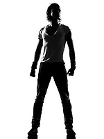 full length silhouette of a young man dancer dancing standing funky hip hop r&b on  isolated  studio white background