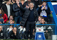 Football - 2016/2017 Premier League - Chelsea V Manchester United<br /> <br /> Manchester United Manager Jose Mourinho with his arm in the air questioning a decision at Stamford Bridge.<br /> <br /> COLORSPORT/DANIEL BEARHAM