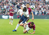 Football - 2018 / 2019 Premier League - West Ham United vs. Tottenham Hotspur<br /> <br /> Aaron Cresswell (West Ham United) tackles Moussa Sissoko (Tottenham FC) at the London Stadium<br /> <br /> COLORSPORT/DANIEL BEARHAM