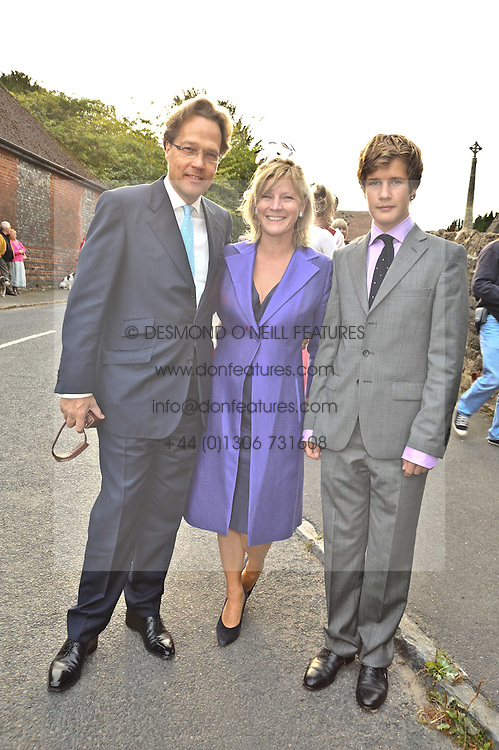 THE EARL & COUNTESS OF MARCH and KINVARA and their son LORD SETTRINGTON at the wedding of Lohralee Stutz and the Hon.William Astor at St.Augustine's Church, East Hendred, Oxfordshire on 5th September 2009.