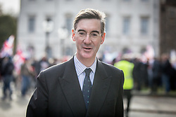 © Licensed to London News Pictures. 23/11/2016. London, UK. Conservative MP Jacob Rees-Mogg walks along Millbank after speaking at a Pro-brexit demonstration outside the Houses of Parliament, calling for a 'hard Brexit' on the day Chancellor of the Exchequer Philip Hammond releases the autumn statement. Photo credit : Tom Nicholson/LNP