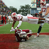 South Carolina Gamecocks quarterback Connor Shaw (14) catches a touchdown pass on a trick play as Wisconsin Badgers cornerback Darius Hillary (5) flies bye during the second quarter of the NCAA Capital One Bowl football game between the South Carolina Gamecocks who represent the SEC and the Wisconsin Badgers who represent the Big 10 Conference, at the Florida Citrus Bowl on Wednesday, January 1, 2014 in Orlando, Florida. (AP Photo/Alex Menendez)