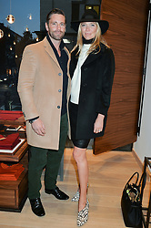 JODIE KIDD and DAVID BLAKELEY at a party to celebrate the re-opening of the Jaeger Chelsea Store in association with the NSPCC at 145 Kings Road, London on 24th September 2014.