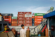 Crew taking a break before having preparing to load the ship with cargo. The Port of Jakarta also known as Tanjung Priok Port is the largest Indonesian seaport and one of the largest seaports in the Java Sea basin, with an annual traffic capacity of around 45 million tonnes of cargo and 4,000,000 TEU's.This port is located in Tanjung Priok, North Jakarta.