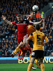 Bristol City's Lewin Nyatanga climbs highest- Photo mandatory by-line: Matt Bunn/JMP  - Tel: Mobile:07966 386802 19/04/2013 - Hull City v Bristol City - SPORT - FOOTBALL - Championship -  Hull- KC Stadium