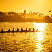 Rowing Crew Newport Beach Panorama Photo. The rowing team is in Newport Bay (Newport Harbor) with Corona Del Mar in the background. Newport Beach is an affluent coastal city along the Pacific Ocean in Orange County Southern California.