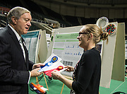 Alison Brittain receives a 1st and 2nd place ribbon from president Duane Nellis during the 2018 Student Research Expo.