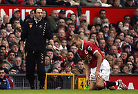 Photo: Paul Thomas.<br /> Manchester United v Aston Villa. The FA Cup. 07/01/2007.<br /> <br /> Man Utd new player Henrik Larsson (R) sits on the floor after a tackle while his old boss at Celtic (Now Villa manager, Martin O'Neill) talks to his players.