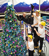 Louie Spence pirouettes into B &amp; Q <br /> to jazz up tallest tree<br /> at B &amp; Q Wandsworth<br /> Pinapple Dance Studios star Louie Spence launching B &amp; Q's bigger, better, bolder Christmas range for 2011 with the help of 4 builders! <br /> 27th October 2011 <br /> <br /> <br /> Louie Spence<br /> <br />  <br /> <br /> <br /> Photograph by Elliott Franks