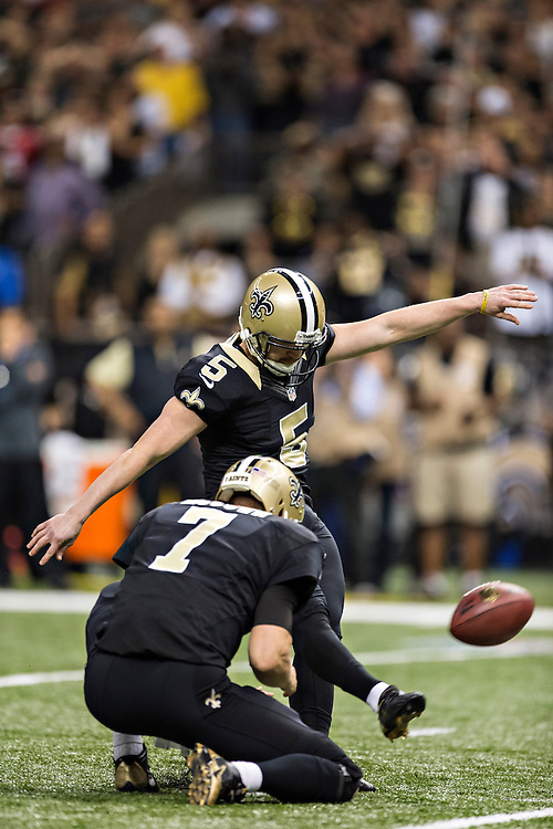 NEW ORLEANS, LA - NOVEMBER 17:  Garrett Hartley #5 of the New Orleans Saints kicks the game winning field goal against the San Francisco 49ers at Mercedes-Benz Superdome on November 17, 2013 in New Orleans, Louisiana.  The Saints defeated the 49ers 23-20.  (Photo by Wesley Hitt/Getty Images) *** Local Caption *** Garrett Hartley