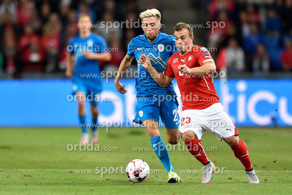 05.09.2015, St. Jakob Park, Basel, SUI, UEFA Euro 2016 Qualifikation, Schweiz vs Slowenien, Gruppe E, im Bild Kevin Kampl (SVN) gegen Xherdan Shaqiri (SUI) // during the UEFA EURO 2016 qualifier group E match between Switzerland and Slovenia at the St. Jakob Park in Basel, Switzerland on 2015/09/05. EXPA Pictures &copy; 2015, PhotoCredit: EXPA/ Freshfocus/ Urs Lindt<br /> <br /> *****ATTENTION - for AUT, SLO, CRO, SRB, BIH, MAZ only*****