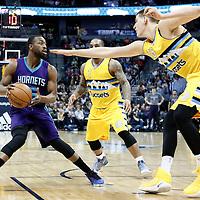 04 March 2017: Denver Nuggets forward Nikola Jokic (15) defends on Charlotte Hornets guard Kemba Walker (15) during the Charlotte Hornets 112-102 victory over the Denver Nuggets, at the Pepsi Center, Denver, Colorado, USA.