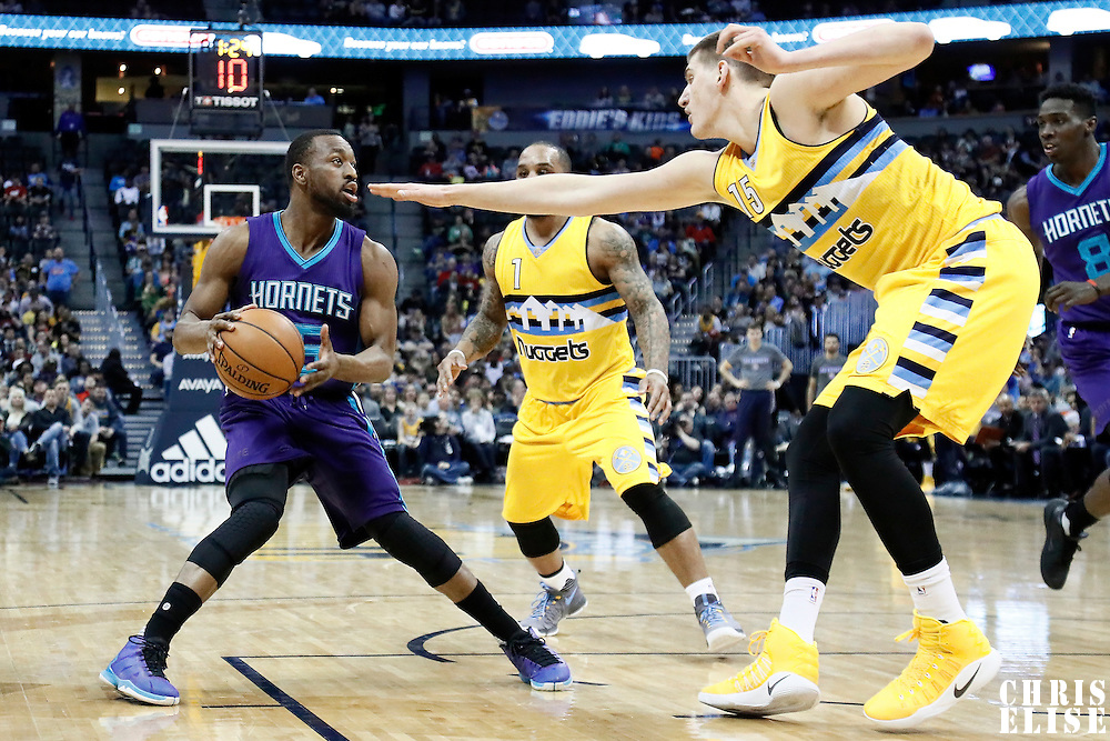 04 March 2017: Denver Nuggets forward Nikola Jokic (15) defends on Charlotte Hornets guard Kemba Walker (15) during the Charlotte Hornets 112-102 victory over the Denver Nuggets, at the Pepsi Center, Denver, Colorado, USA.