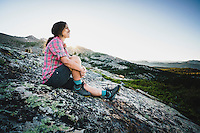 Backpacker Alexa Ault enjoys sunset in Stough Creek Basin, Wind River Range, Wyoming.
