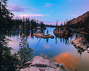 THIS PHOTO IS AVAILABLE FOR WEB DOWNLOAD ONLY. PLEASE CONTACT US FOR A LARGER PHOTO. Idaho. Central. Imogene Lake at sunset in the Sawtooth Wilderness area with clouds reflecting in water.