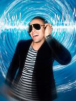 Man wearing headphones in front of circular effect half-length