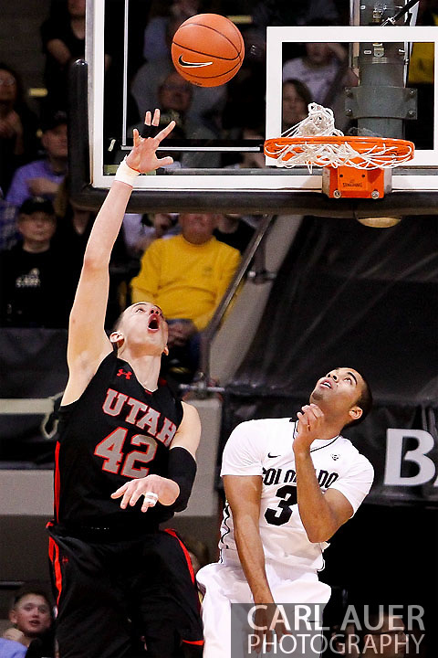 February 21st, 2013 Boulder, CO - University of Utah Utes senior center Jason Washburn (42) reverses a shot up over Colorado Buffaloes freshman guard Xavier Talton (3) in the first half of action during the NCAA basketball game between the University of Utah Utes and the University of Colorado Buffaloes at the Coors Events Center in Boulder CO