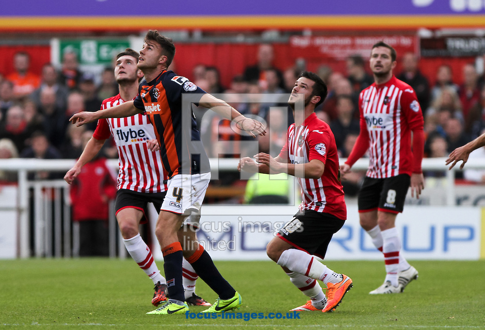 Jimmy Keohane (front right) of Exeter City and Jonathan Smith (front left) of Luton Town both look for the ball during the Sky Bet League 2 match at St James' Park, Exeter<br /> Picture by Tom Smith/Focus Images Ltd 07545141164<br /> 01/11/2014