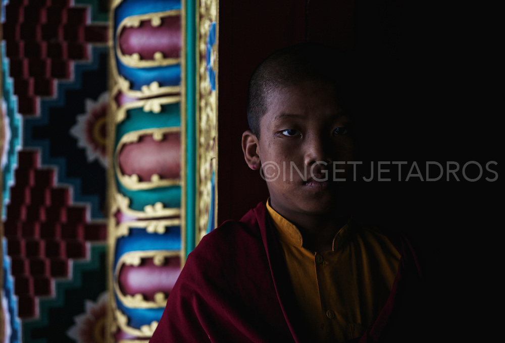Young Lama at the doorways of Padma Sambhav Mahavihar Monastery Jeerang ,Chandragiri.It is widely known for the Tibetan refugee Colony , where immigrants from Tibet have been rehabilitated.Chinese invasion and occupation of Tibet in 1959 forced about 85,000 Tibetans including their religious and political head His Holiness 14th Dalai Lama to seek shelter in India.Padma Sambhav Mahavihar' the largest Tibetan monastery in eastern India & can be considered one of the largest in south Asia.....Photo by Ingetje Tadros..