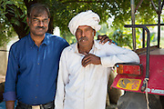 Ashok (left) Senior Manager at AKRSP, with one of the farmers he works with, India.