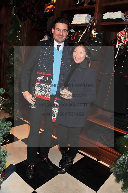 BEATRIX ONG and EDWARD TAYLOR at a party hosted by TLC to celebrate signing their 5000th member and Ralph Lauren to celebrate the opening of the first Ralph Lauren Rugby store in the UK at 43 King Street, Covent Garden, London on 30th November 2011.