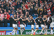 Brentford striker Scott Hogan (9) celebrates his second goal 2-0 during the EFL Sky Bet Championship match between Brighton and Hove Albion and Brentford at the American Express Community Stadium, Brighton and Hove, England on 10 September 2016. Photo by Bennett Dean.