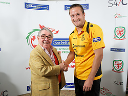 CARDIFF, WALES - Tuesday, August 14, 2012: Carmarthen Town's Paul Fowler with Ronnie Corbett, the sporting ambassador ot Corbett Sport, at the launch the 2012/2013 Welsh Premier League at the St. David's Hotel. (Pic by David Rawcliffe/Propaganda)