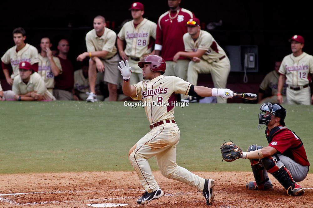 June 05, 2011; Tallahassee, FL, USA; Florida State Seminoles second baseman Devon Travis (8) hits a one run single against the Alabama Crimson Tide during the fourth inning of the Tallahassee regional of the 2011 NCAA baseball tournament at Dick Howser Stadium. Mandatory Credit: Derick E. Hingle