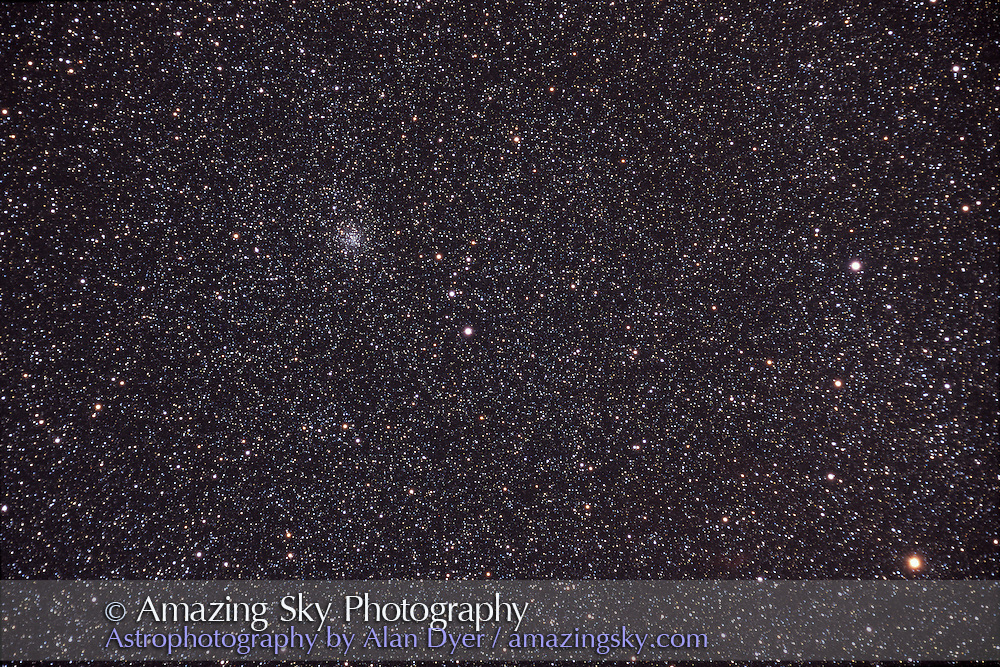 M71 globular cluster in Sagitta. Delta Sagittae at lower right.<br /> Taken with Astro-Physics 5-inch 130EDT apo refractor at f/6 (no field flattener) and 35mm format Ektachrome E200 slide film. 40 minute exposure. Taken from home in October 2003.