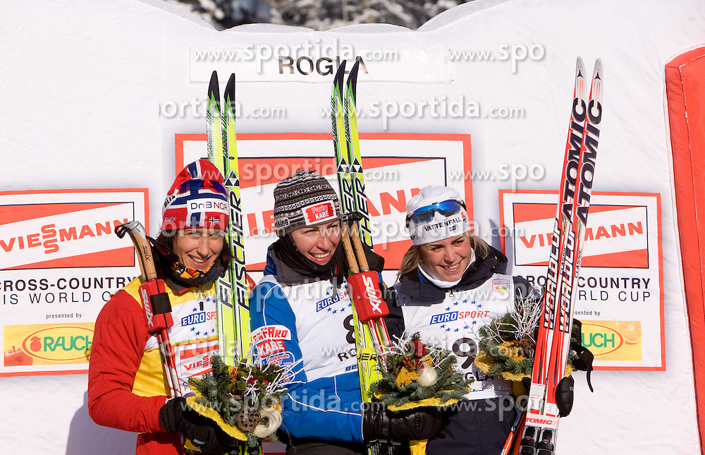 Second placed Marit Bjoergen of Norway, winner Justyna Kowalczyk of Poland and third placed Anna Haag of Sweden at medal ceremony after the Ladies 15 km Classic Mass Start Competition of Viessmann Cross Country FIS World Cup Rogla 2009, on December 20, 2009, in Rogla, Slovenia. (Photo by Vid Ponikvar / Sportida)