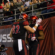 18 November 2017:  The San Diego State football team hosts Nevada Saturday night. San Diego State Aztecs tight end Parker Houston (82) congratulates running back Rashaad Penny after scoring a touchdown in the first quarter. The Aztecs lead 21-14 at the half. <br /> www.sdsuaztecphotos.com