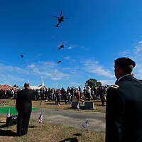 Thomas Wells | BUY AT PHOTOS.DJOURNAL.COM<br /> A flight of AH-64 Apache's from Tupelo perform the missing man formation at the conclusion of Cpl. George Mason's funeral service on Tuesday.