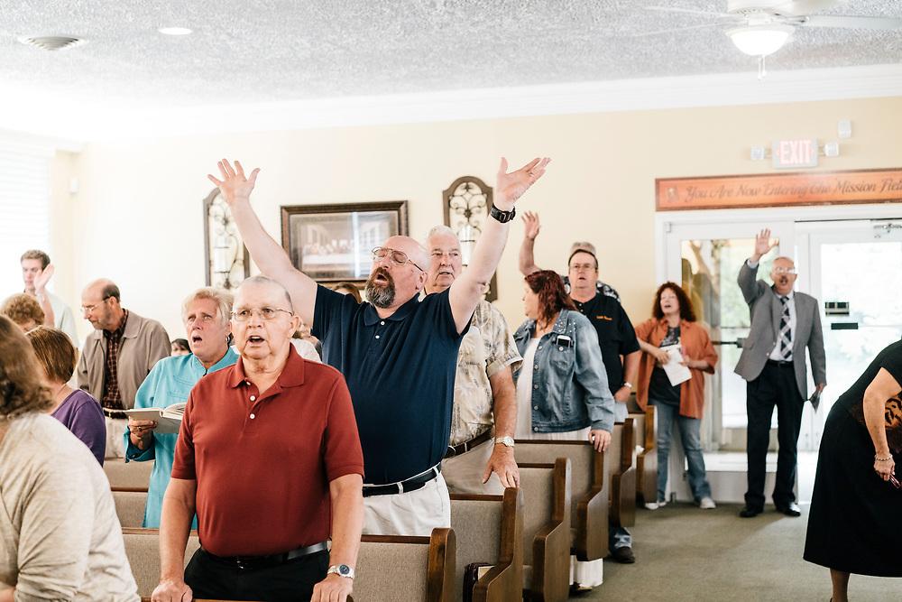 Church members pray during service at Full Gospel Pentecostal Church in Martinsburg, WV on June 4, 2017.