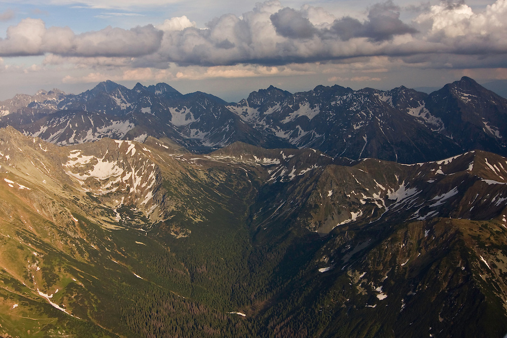 Aerial view of the end of Ticha valley and the High Tatras with Mount Krivan (2495m als) on the right and Mount Gerlach (2655m asl) in the background. Western Tatras, Slovakia. June 2009. Mission: Ticha