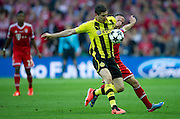 (L) Robert Lewandowski of Dortmund fights for the ball with (R) Franck Ribery of Monachium during the UEFA Champions League Final football match between Borussia Dortmund and Bayern Munich at Wembley Stadium in London on May 25, 2013...England, London, May 25, 2013..Picture also available in RAW (NEF) or TIFF format on special request...For editorial use only. Any commercial or promotional use requires permission...Photo by © Adam Nurkiewicz / Mediasport
