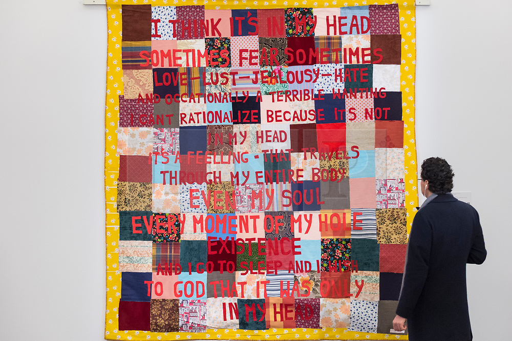 © Licensed to London News Pictures. 01/03/2019. LONDON, UK. A visitor views ''I Think It's In My Head'', 2002, by Tracey Emin, (Est. £500,000 - 700,000).  Preview of Sotheby's Contemporary Art Sale in their New Bond Street galleries.  Works by artists including Tracey Emin, Jenny Saville, Jean-Michel Basquiat and Andy Warhol will be offered for auction on 5 March 2019.  Photo credit: Stephen Chung/LNP