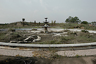 A large fountain in the entrance of the Eagle's Nest Palace, one of three extravagant residences built by the former ruler of Zaire Mobutu Sese Seko outside his native village of Gbadolite in Equateur province. The town and properties were looted by rebel forces during the country's civil war..Kawele, DR Congo. 18/03/2009..Photo © J.B. Russell