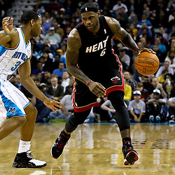 November 5, 2010; New Orleans, LA, USA;  Miami Heat small forward LeBron James (6) is guarded by New Orleans Hornets shooting guard Willie Green (33) during a game against the New Orleans Hornets at the New Orleans Arena. The Hornets defeated the Heat 96-93. Mandatory Credit: Derick E. Hingle