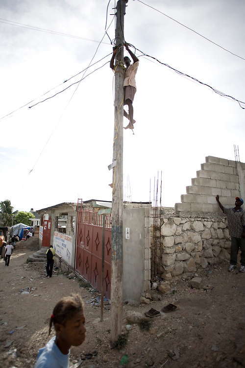 A man ilegally hooks up a powerline.