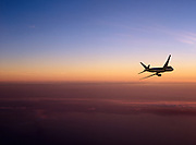 Airliner banking away at sunset.