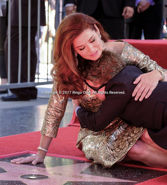 Actress Debra Messing and her son Roman Walker Zelman at a ceremony honoring her with a star on the Hollywood Walk of Fame on Friday, Oct. 5, 2017, in Los Angeles.(Photo by Ringo Chiu)<br /> <br /> Usage Notes: This content is intended for editorial use only. For other uses, additional clearances may be required.