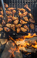 Jeff Leupold, of Philadelphia, grills chicken wings over a campfire before serving them with an Alabama White Sauce during a camping trip with friends at Wharton State Forest in New Jersey on February 7, 2015.