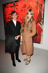 JOHNNY BORRELL and Edie Campbell at a private view of Nicolas Pol's paintings entitled 'Mother of Pouacrus' held at The Dairy, Wakefield Street, London WC1 on 14th October 2010.